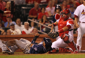 St. Louis Cardinals catcher A.J. Pierzynski reaches out to tag San Diego Padres Alexi Amarista for the out in the ninth inning at Busch Stadium in St. Louis on August 14, 2014. St. Louis won the game 4-3.   UPI/Bill Greenblatt