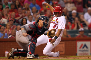 St. Louis Cardinals Jhonny Peralta slides safely past Boston Red Sox catcher Christian Vazquez in the first inning at Busch Stadium in St. Louis on August 7, 2014. Peralta scored from second base on a hit by Oscar Taveras.    UPI/Bill Greenblatt