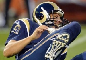 Sam Bradford yells out in pain after getting hurt in the first quarter (photo/NFL)