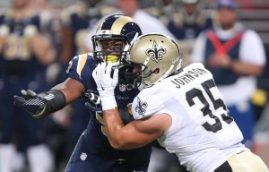St. Louis Rams Michael Sam (L) is restrained by New Orleans Saints Austin Johnson in the second quarter at the Edward Jones Dome in St. Louis on August 8, 2014.  UPI/Bill Greenblatt