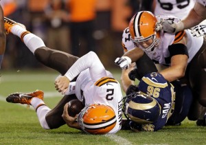 Michael Sam and Johnny Manziel meet on the ground after Sam brings the Cleveland QB down with a sack in the fourth quarter (photo/StLouisRams.com)