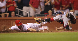 St. Louis Cardinals Shane Robinson slides safely past  Boston Red Sox catcher Christian Vazquez for the tying run in the seventh inning at Busch Stadium in St. Louis on August 5, 2014.  UPI/Bill Greenblatt
