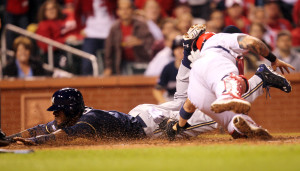 MIlwaukee Brewers Hector Gomez slides headfirst into home plate before the tag by St. Louis Cardinals Yadier Molina to tie the game in the ninth inning at Busch Stadium in St. Louis on September 16, 2014. Milwaukee won the game 3-2 in 12 innings.    UPI/Bill Greenblatt
