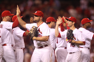 St. Louis Cardinals Matt Holliday (L) and Randal Grichuk come off the field to high fives with teammates after a 2-1 win over the Cincinnati Reds at Busch Stadium in St. Louis on September 19, 2014. Holiday and Grichuk combined for two solo home runs, enough for the win.  UPI/Bill Greenblatt