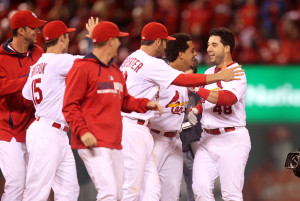 St. Louis Cardinals Tony Cruz (R) celebrates his game winning RBI single in the 13th inning with teammates against the MIlwaukee Brewers at Busch Stadium in St. Louis on September 18, 2014. St. Louis won the game 3-2.  UPI/Bill Greenblatt
