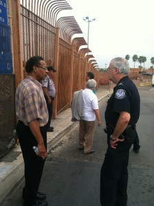 Congressman Emanuel Cleaver II talks with an official during his visit to facilities dealing with children who have been streaming into the U.S. from Central American countries.  (Courtesy; office of Congressman Cleaver)