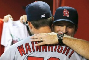 Adam Wainwright and Manager Mike Matheny embrace in the first inning after learning the Cardinals clinched the NL Central. (photo/MLB)