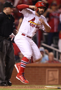 St. Louis Cardinals Daniel Descalso jumps after scoring from second base on a RBI single by Xavier Scruggs in the fifth inning against the Cincinnati Reds at Busch Stadium in St. Louis on September 21, 2014.  UPI/Bill Greenblatt