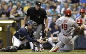 Jon Jay slides home safely on Yadier Molina's single in the first. (photo/MLB)