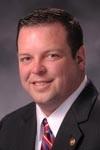 Representative Kevin Elmer, R-Nixa, carried the gun legislation in the House.