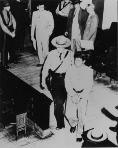 Joe Vidauri is walked into Cole County Circuit Court in October, 1954.  (Courtesy; Missouri State Archives and Mark Schreiber)