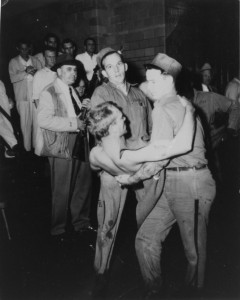 A wounded inmate is carried by fellows through the lobby of MSP to the prison hospital during the riot.  (Courtesy; Missouri State Archives and Mark Schreiber)