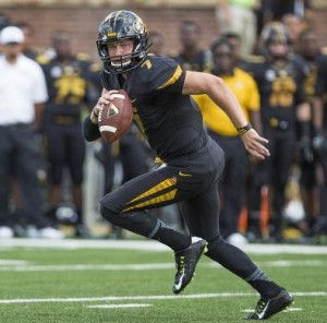 Maty Mauk scrambles to find a receiver in Saturday's opener against South Dakota State (photo/Mizzou)