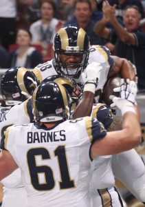 St. Louis Rams Lance Kendricks jumps into the arms of teammates after catching a touchdown pass in the first quarter against the Dallas Cowboys at the Edward Jones Dome in St. Louis on September 21, 2014. UPI/Bill Greenblatt