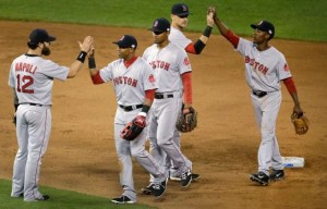 The Red Sox celebrate their 6-3 win over the Royals (photo/MLB)