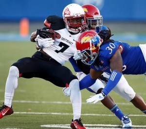 SEMO's Paul Lloyd is hit by two KU defenders.  (photo/KU Athletics)