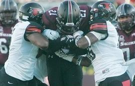 Two Redhawk defenders wrap up an SIU ball carrier (photo/SEMO Athletics)