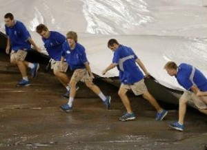The ground crew pulled out the tarp in the 10th inning back on August 31st.  (photo/MLB)