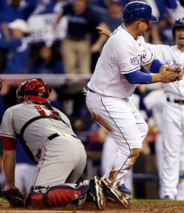 Billy Butler reacts after scoring from first on a double in the first inning (photo/MLB)