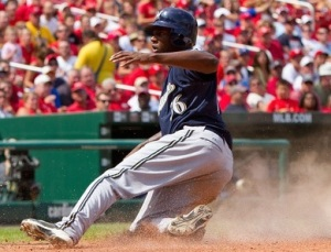 Lorenzo Cain slides into home scoring a run for the Brewers in a game against the Cardinals on Aug 18, 2010 (photo/MLB)