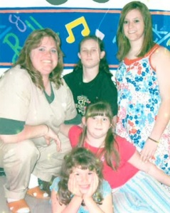 Donna Biernacki is pictured with her four daughters. She has been in prison since 2004 for the murder of her husband. The Coalition says portions of the jury instructions regarding battered spouse syndrome were not introduced at her trial, leaving the jury unaware it could use evidence of abuse to find her not guilty. (photo courtesy; the Community Coalition for Clemency)