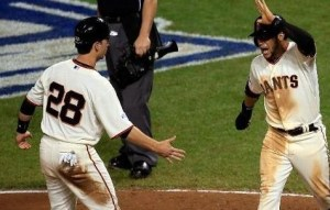 Buster Posey and Gregor Blanco celebrate the go-ahead run for the Giants in the sixth (photo/MLB)
