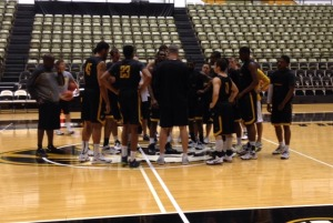 Kim Anderson rounds up the troops at Monday's practice at the Hearnes Center.