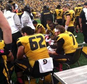 Offensive lineman Taylor Chappel (62) and quarterback Maty Mauk (7) try to regroup on the sidelines. (photo/Emily  Dayton)