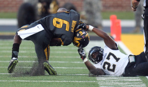 Vanderbilt Commadores Jahmel McIntosh takes down Missouri Tigers Marcus Murphy by the neck in the fourth quarter at Farout Field in Columbia, Missouri on October 25, 2014.   UPI/Bill Greenblatt