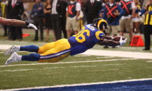 St. Louis Rams Benny Cunningham dives into the endzone for a touchdown in the first quarter against the San Francisco 49er's at the Edward Jones Dome in St. Louis on October 13, 2014.   UPI/Bill Greenblatt