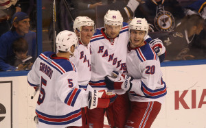 New York Rangers Rick Nash (61) is congratulated by teammates after scoring the winning goal in the third period against the St. Louis Blues at the Scottrade Center in St. Louis on October 9, 2014. New York won the game 3-2.  UPI/Bill Greenblatt