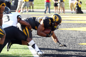 Missouri Tigers Russell Hansbrough dives into the endzone against the Vanderbilt Commadores in the second quarter at Farout Field in Columbia, Missouri on October 25, 2014.   UPI/Bill Greenblatt