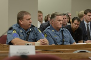 State Highway Patrol Sergeant Randy Henry (left) testifies while seated next to Patrol Superintendent Ron Replogle.  Brandon Ellingson's father, Craig (black polo shirt) listens intently.  (photo courtesy; Tim Bommel, Missouri House Communications)