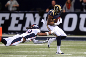 St. Louis Rams Kenny Britt catches the football in front of the diving Denver Broncos Bradley Roby for a 63 yard touchdown in the first quarter at the Edward Jones Dome in St. Louis on November 16, 2014. UPI/Bill Greenblatt