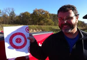 Bill Pollock shows off his first three shots while sighting in his rifle (Photo/Karen Hudson)