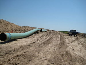 The Keystone XL Pipeline under construction (courtesy; Wikimedia commons)
