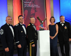 Army Gen. Frank Grass, Chief, National Guard Bureau and former Missouri National Guardsman, receives the American Patriot Award on behalf of the National Guard from former Missouri Guardswoman Cathleen Pearl, President and Chief Executive Officer, National Defense University Foundation and Albert Zimmerman, chairman of the National Defense University Foundation Board of Directors, Washington, D.C.  Grass, along with Air Force Lt. Gen. Joseph L. Lengyel, and Chief Master Sgt. Mitch Brush, senior enlisted advisor to the chief, National Guard Bureau were presented the award which recognizes exceptional leaders who dedicate their lives to enhancing human security and global stability. (U.S. Air National Guard photo by Tech. Sgt. David Eichaker/released)
