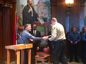 Officer Brad King receives the Medal of Valor.