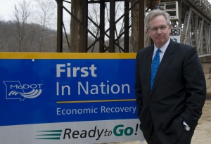Governor Jay Nixon stands by a Department of Transportation sign during a 2009 project.  (courtesy; Missouri Department of Transportation)