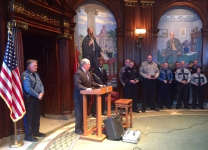 Governor Nixon awards the Medal of Valor to law enforcement officers at a ceremony in his office.