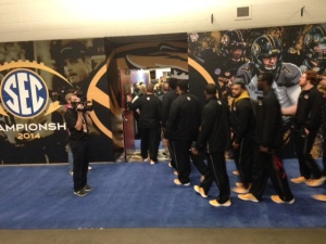 The Missouri Tigers arrive  at the Georgia Dome late Friday afternoon