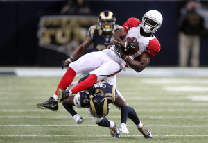 St. Louis Rams E.J. Gaines upends Arizona Cardinals Jaron Brown in the first quarter at the Edward Jones in St. Louis on December 11, 2014.    UPI/Bill Greenblatt