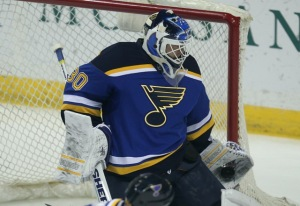 St. Louis Blues goaltender Martin Brodeur makes a glove save against the Colorado Avalanche in the first period at the Scottrade Center in St. Louis on December 29, 2014. UPI/Bill Greenblatt