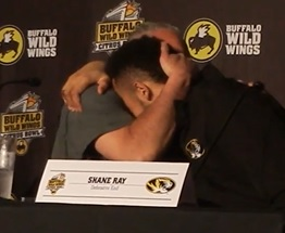 Coach Dave Steckel embraces junior defensive end Shane Ray (photo/Bill Pollock)