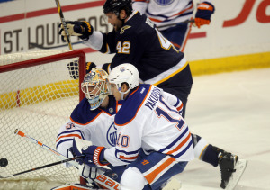 St. Louis Blues David Backes (42) puts the puck past Edmonton Oilers goaltender Ben Scrivens for a goal in the first period at the Scottrade Center in St. Louis on January 13, 2015.    Photo by Bill Greenblatt/UPI