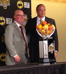 Minnesota head coach Jerry Kill (L) stands with Missouri head coach Gary Pinkel and the Citrus Bowl Trophy (photo/Bill Pollock, Missourinet)