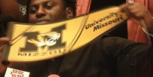 Terry Beckner Jr. displays a Missouri pennant as he makes his announcement on National Signing Day