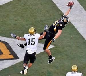Ryan Walters tries to defend Chase Coffman in 2008.  Walters is now a coach for Mizzou.