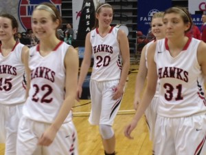 Ashytn Lagemann (20) walks off the court with her teammates after Clopton's third place finish