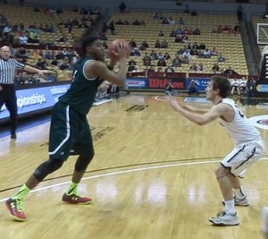 Jeriah Horne of Barstow gets ready to make a move to the basket in the third quarter